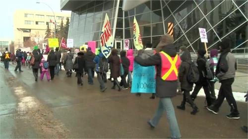 dozens march in edmonton for international women s day