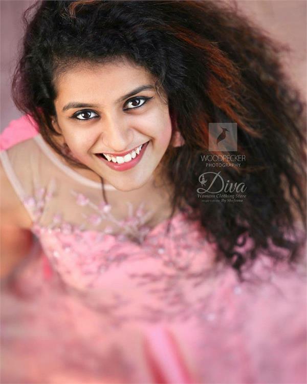 pretty in pink  priya prakash varrier is here to steal hearts yet again