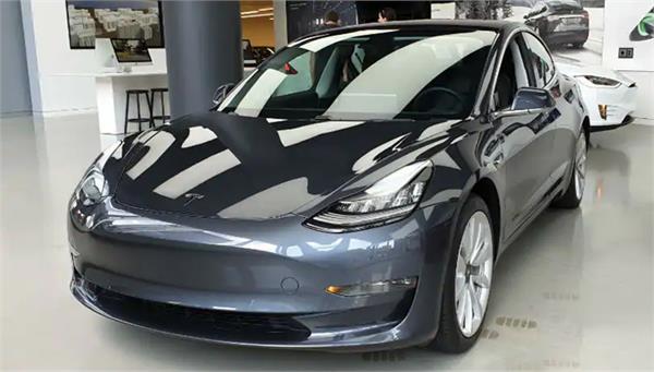 tesla delivers first china made  3 sedans
