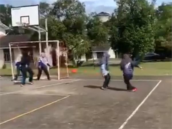 women play football wearing hijab