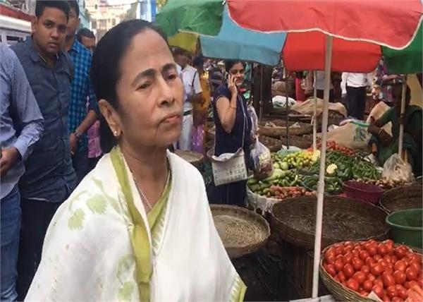 mamata banerjee vegetable market walks potato onion prices