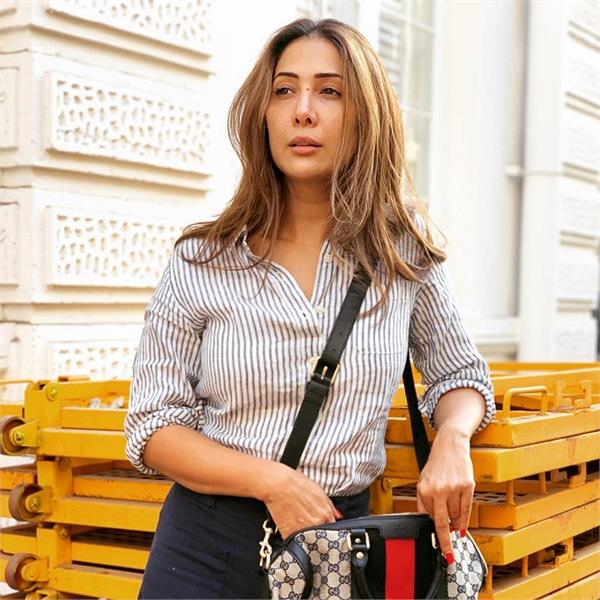 kim sharma for allegedly denying her one month salary