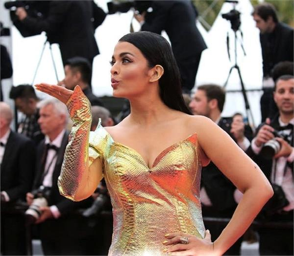 aishwarya rai bachchan stuns in a golden gown at cannes 2019 red carpet