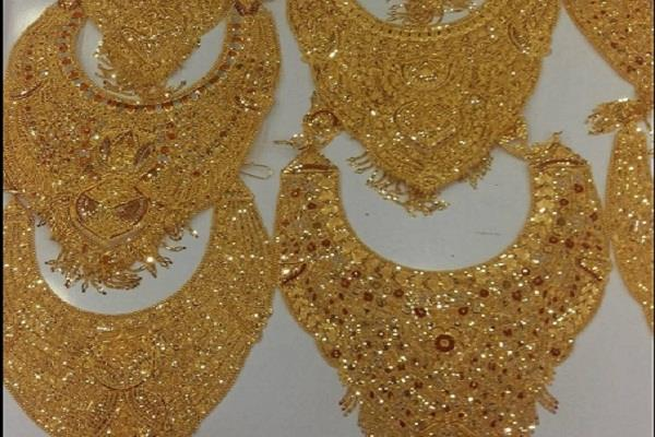 gold lost rs 100 on   silver weakened