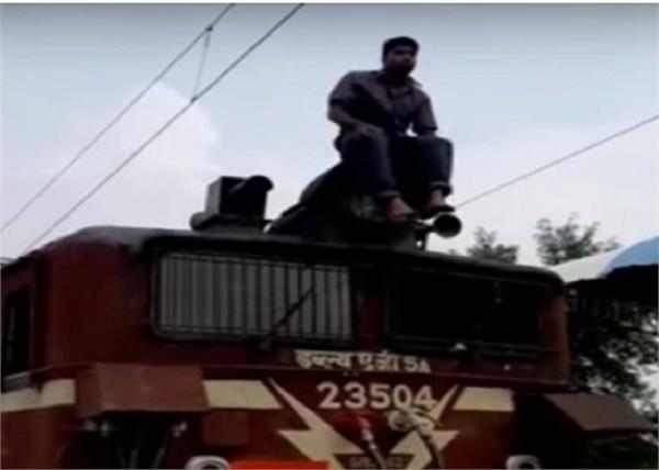 a man train engine roof