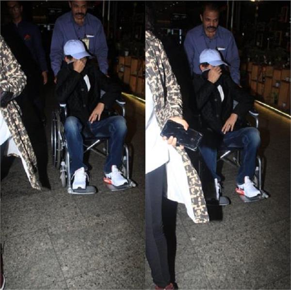 irrfan khan hides his face as he returns to mumbai