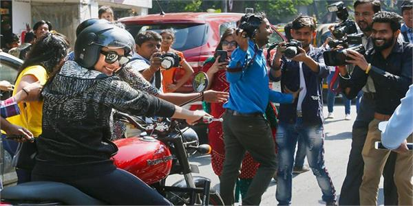sonakshi sinha rides bike on busy mumbai street with bodyguard in tow