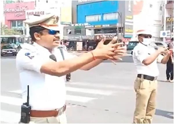 corona virus traffic signal police hand wash